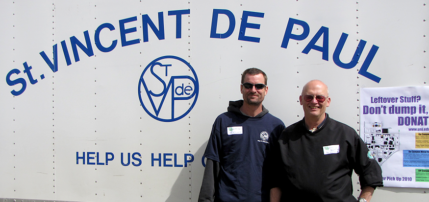 Men in front of St. Vincent De Paul truck